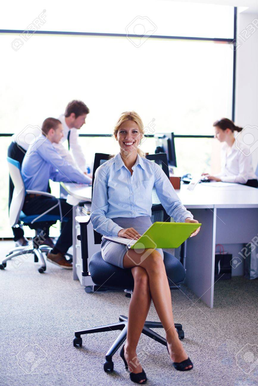 business woman  with her staff,  people group in background at modern bright office indoors Stock Photo - 15528452