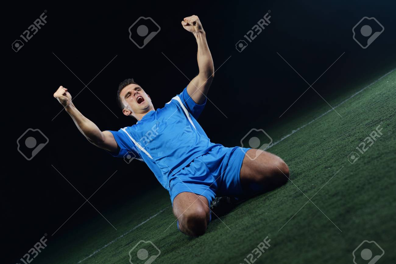 soccer player doing kick with ball on football stadium  field  isolated on black background Stock Photo - 16213714