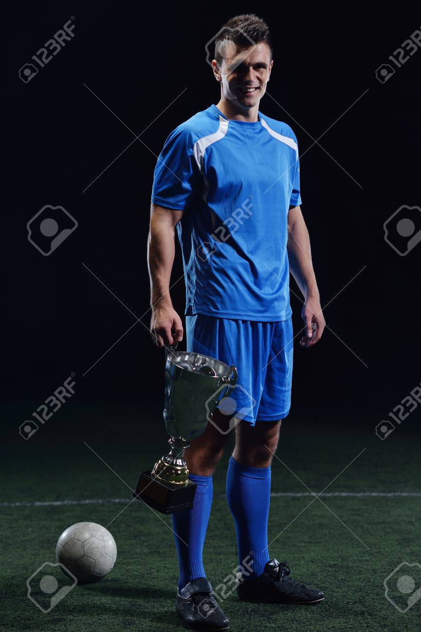 soccer player doing kick with ball on football stadium  field  isolated on black background Stock Photo - 17394550