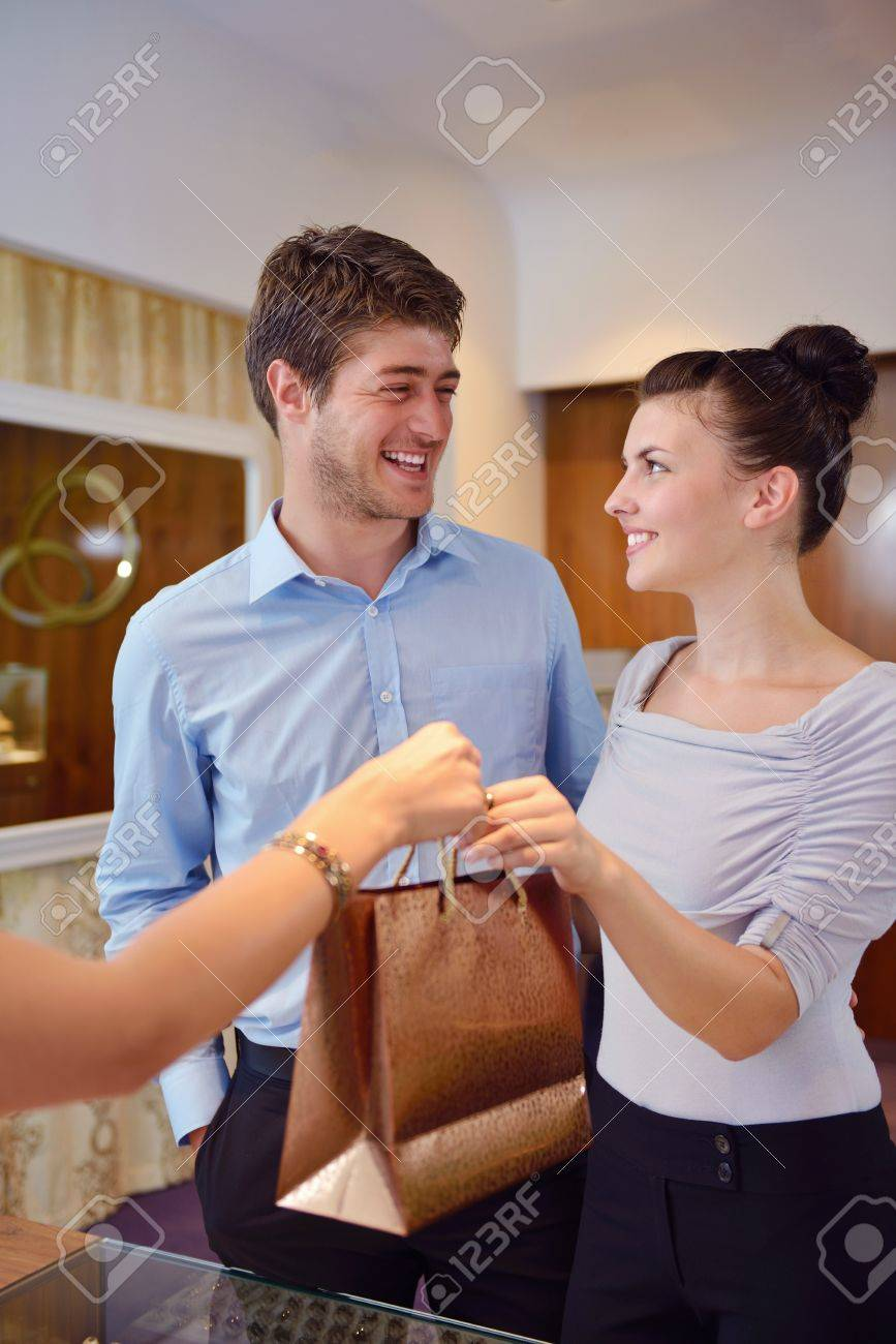 happy young romantic couple in love buy jewelry ring in luxury store Stock Photo - 16503772