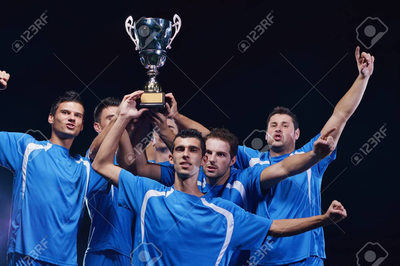 soccer players team group celebrating the victory and become champion of game while holding win coup Stock Photo - 16592736