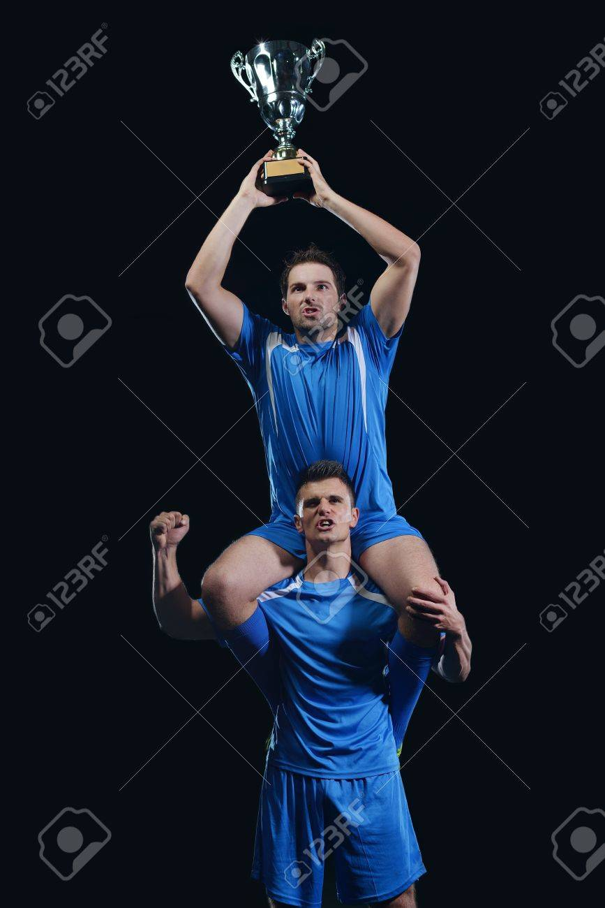 soccer players team group celebrating the victory and become champion of game while holding win coup Stock Photo - 17367136