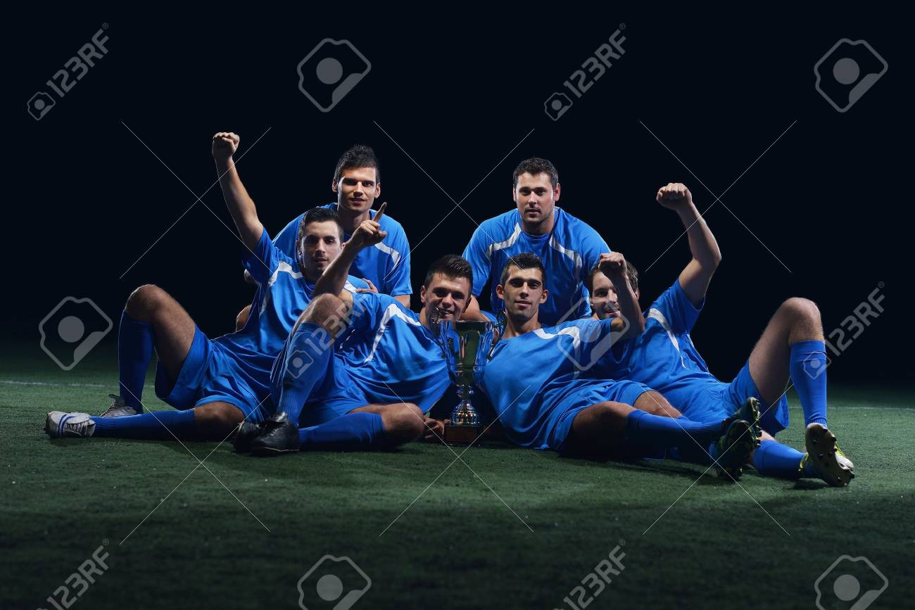 soccer players team group celebrating the victory and become champion of game while holding win coup Stock Photo - 17367148