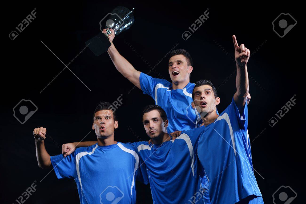 soccer players team group celebrating the victory and become champion of game while holding win coup Stock Photo - 16715091