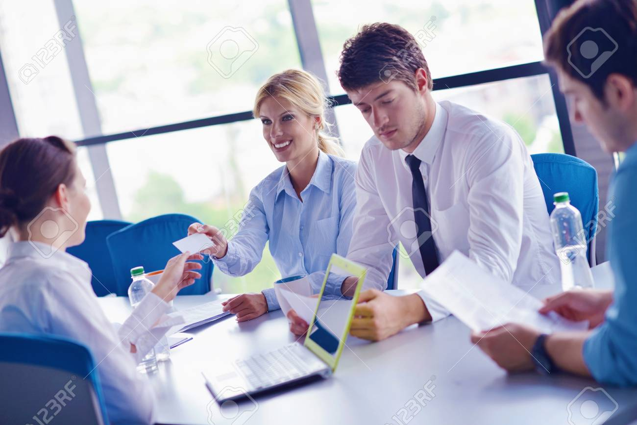 Group of happy young  business people in a meeting at office Stock Photo - 16581309
