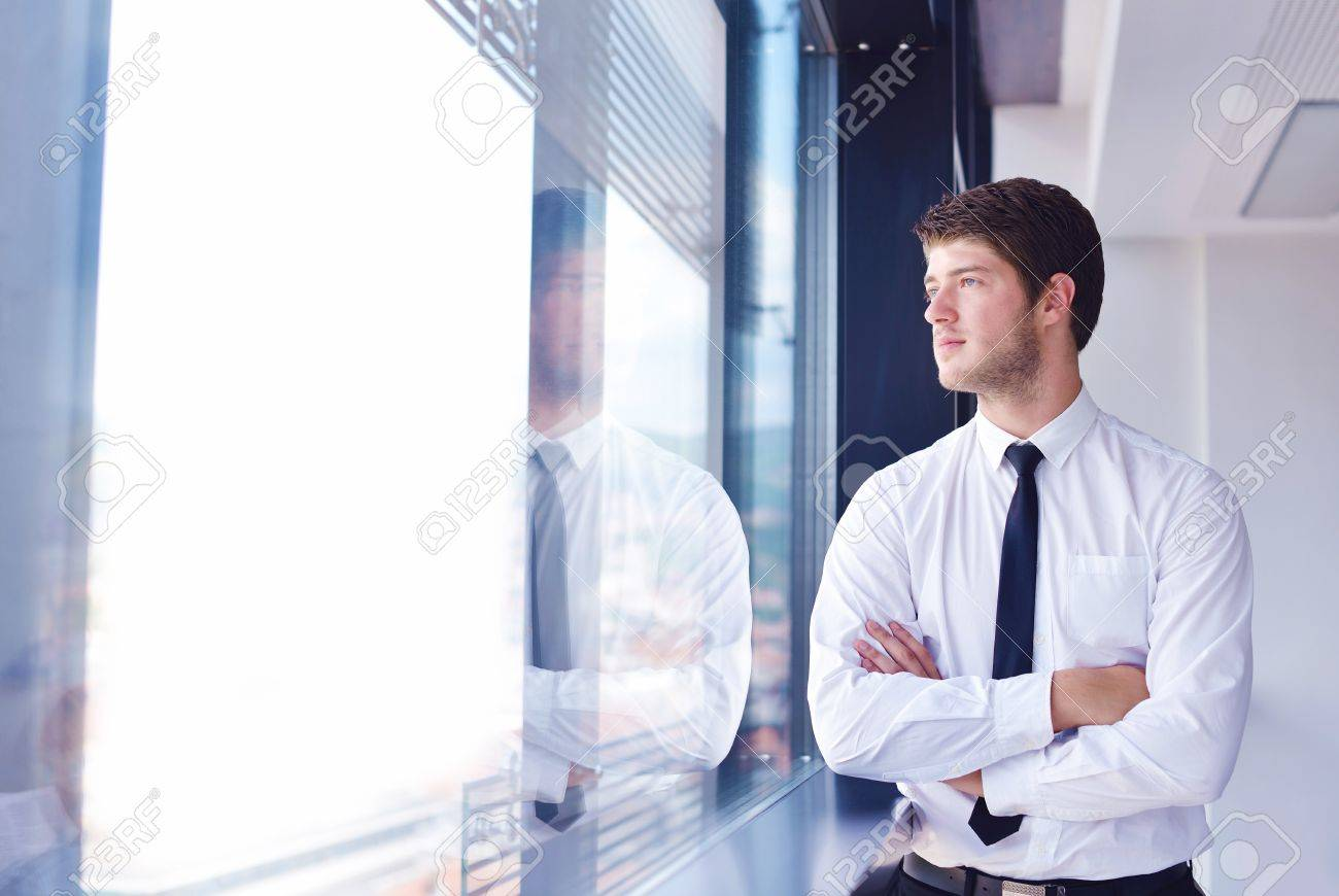 Portrait of a handsome young  business man  on a meeting in offce with colleagues in background Stock Photo - 16580285