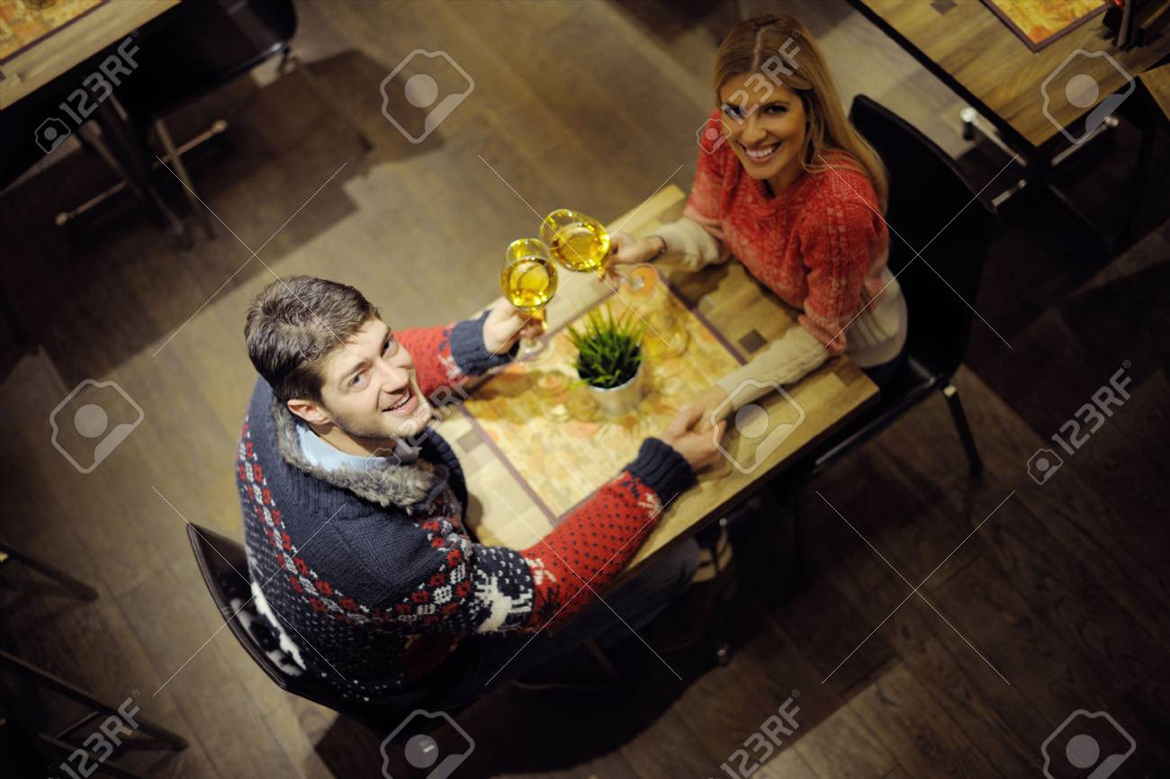 romantic evening date in restaurant  happy young couple with wine glass tea and cake Stock Photo - 17633012