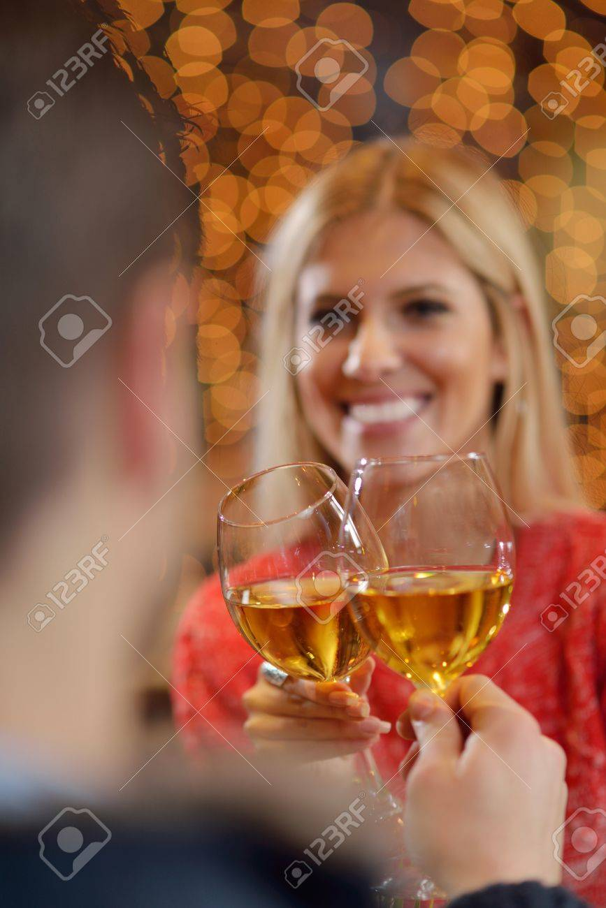 romantic evening date in restaurant  happy young couple with wine glass tea and cake Stock Photo - 17696306