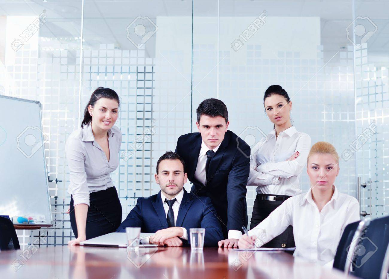 Group Of Happy Young Business People In A Meeting At Office Stock ...