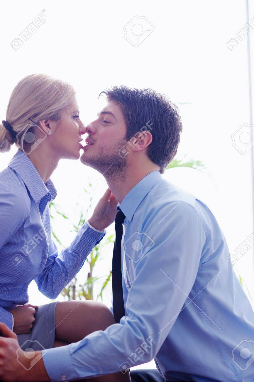 business people in love have romantic time at workplace - 18319308