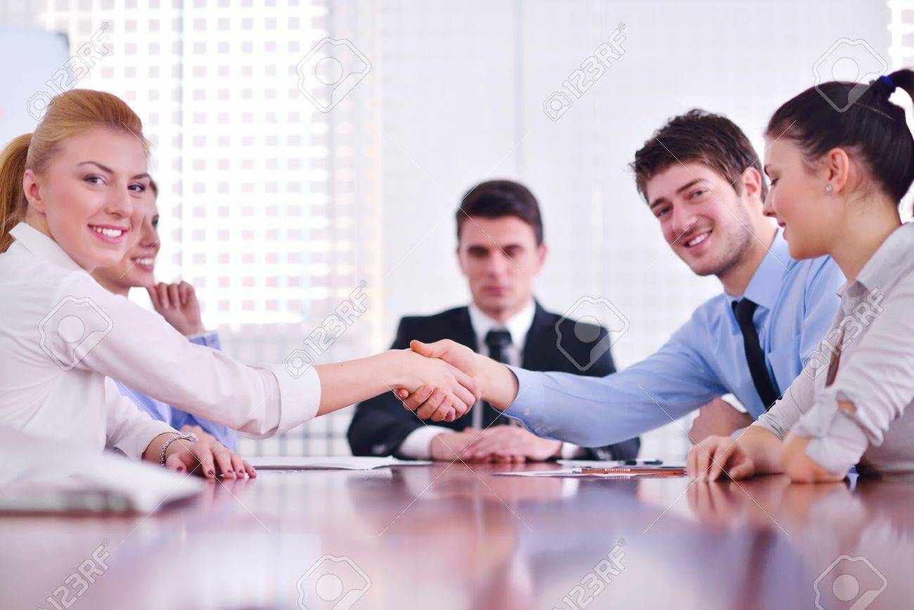 business people shaking hands make deal and sign contract in bright modern office Stock Photo - 18340822