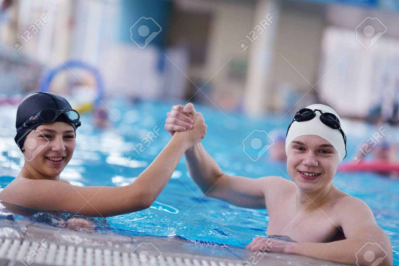 happy children kids group  at swimming pool class  learning to swim Stock Photo - 19559522