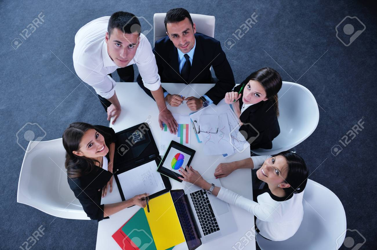 Group of happy young  business people in a meeting at office Stock Photo - 20124983