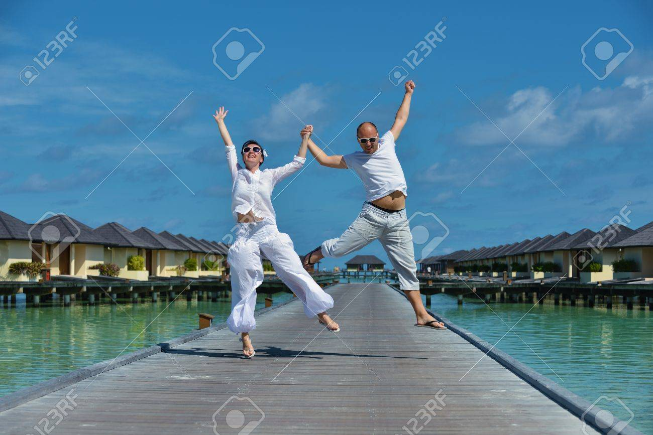 Background image location - Happy Young Couple Have Fun And Relax At Summer Vacation On Background Maldives Travel Location And