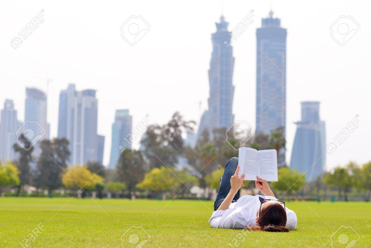 Young student woman reading a book and study in the park Stock Photo - 20826826