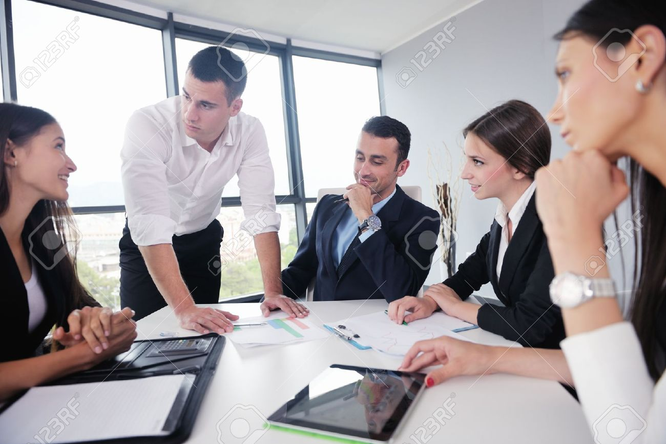 Group of happy young business people in a meeting at office - 22395305