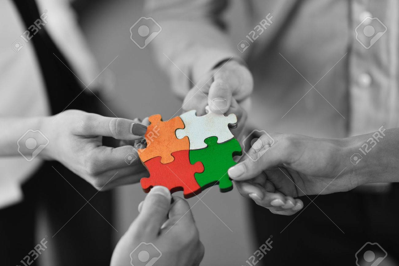 Group of business people assembling jigsaw puzzle and represent team support and help concept Stock Photo - 22395391