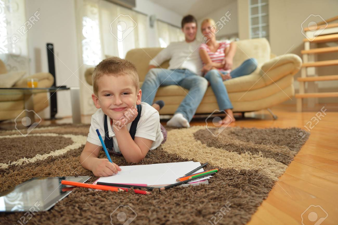 happy young family with kids in bright modern living room have fun and looking big flat lcd tv Stock Photo - 25094861