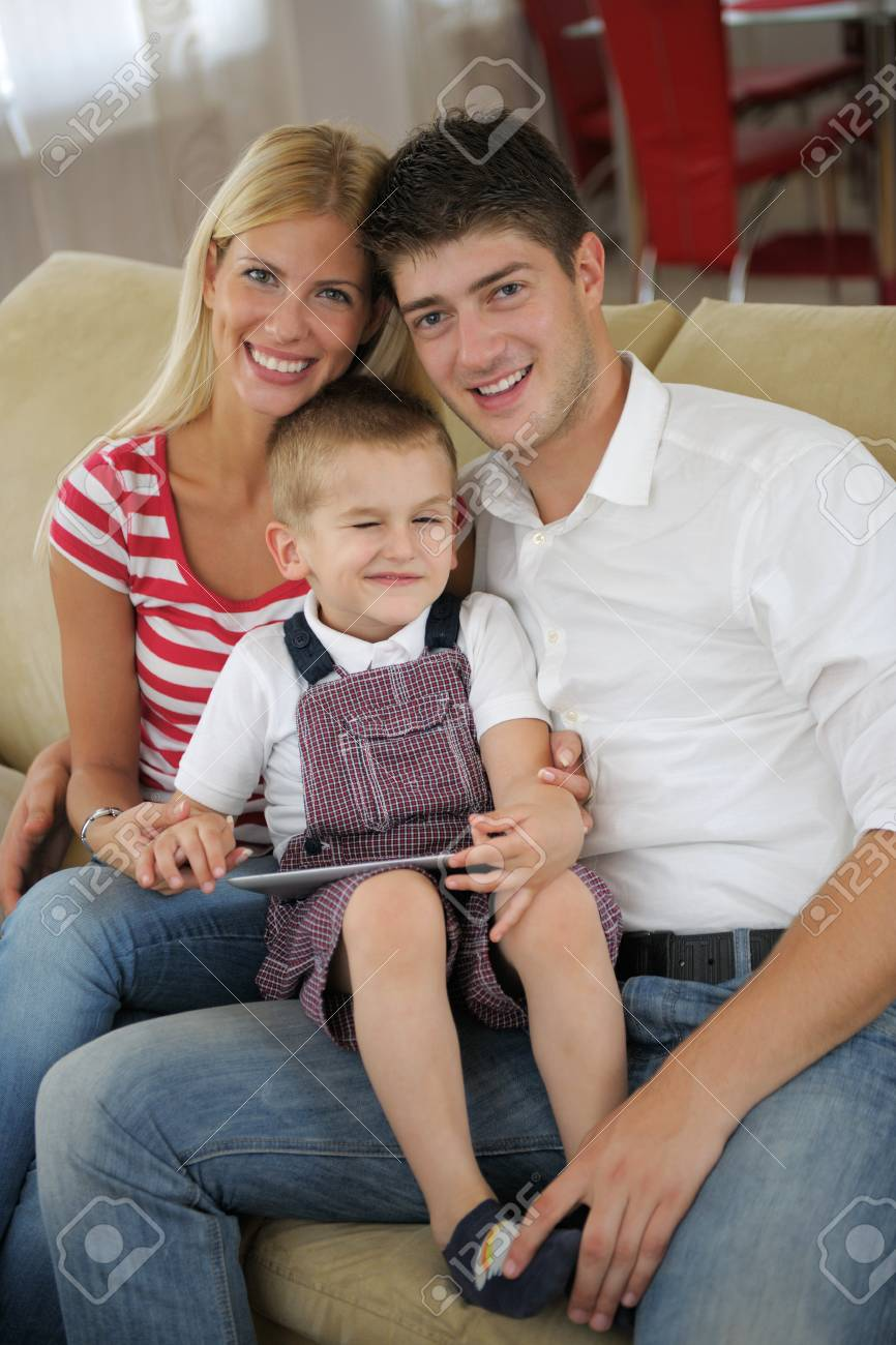 happy young family using tablet computer at modern  home for playing games and education Stock Photo - 25377692