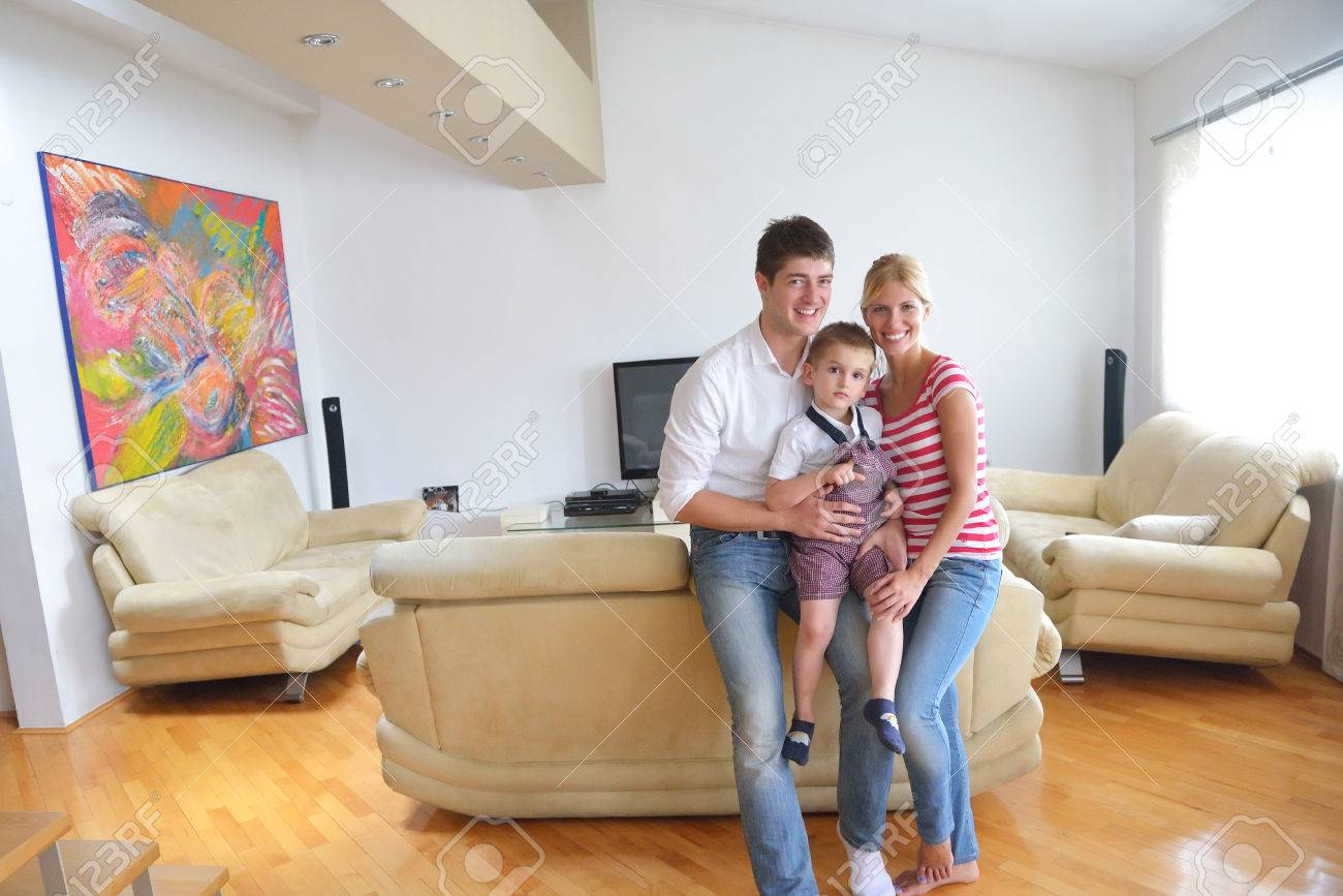 happy young family with kids in bright modern living room have fun and looking big flat  sc 1 st  123RF.com & Happy Young Family With Kids In Bright Modern Living Room Have ...