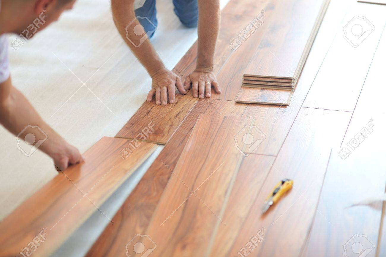 installing laminate flooring. Installing Laminate Flooring In New Home Indoor Stock Photo - 35539905 E