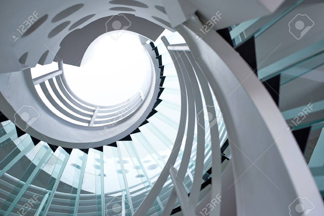 Modern Glass Spiral Staircase With Metallic Hand Rails. Stock Photo    42118385