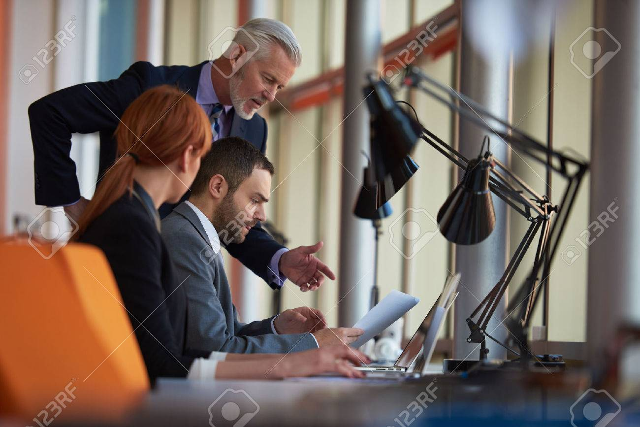 business people group with young adults and senior on meeting at modern bright office interior. Stock Photo - 49121332