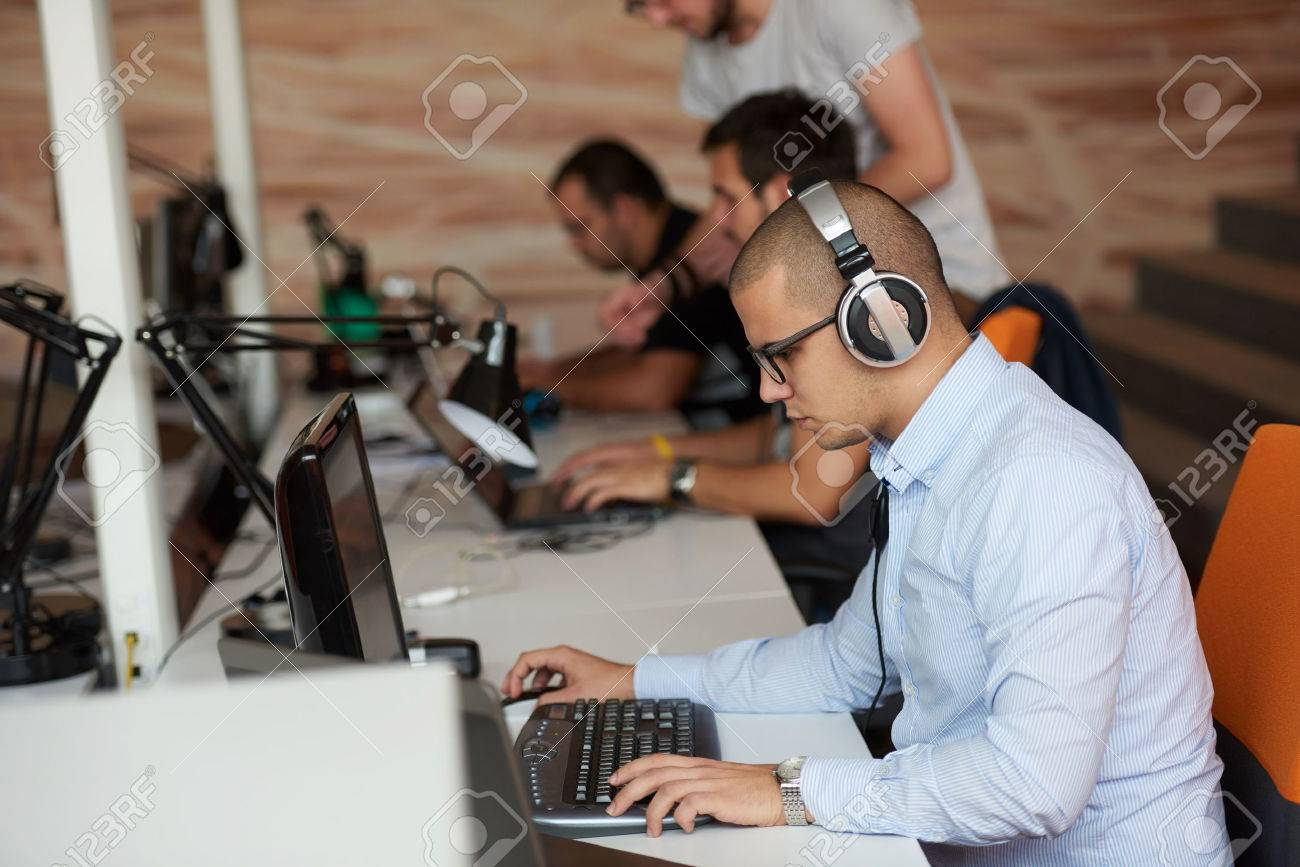 startup business, software developer working on computer at modern office Stock Photo - 49293963