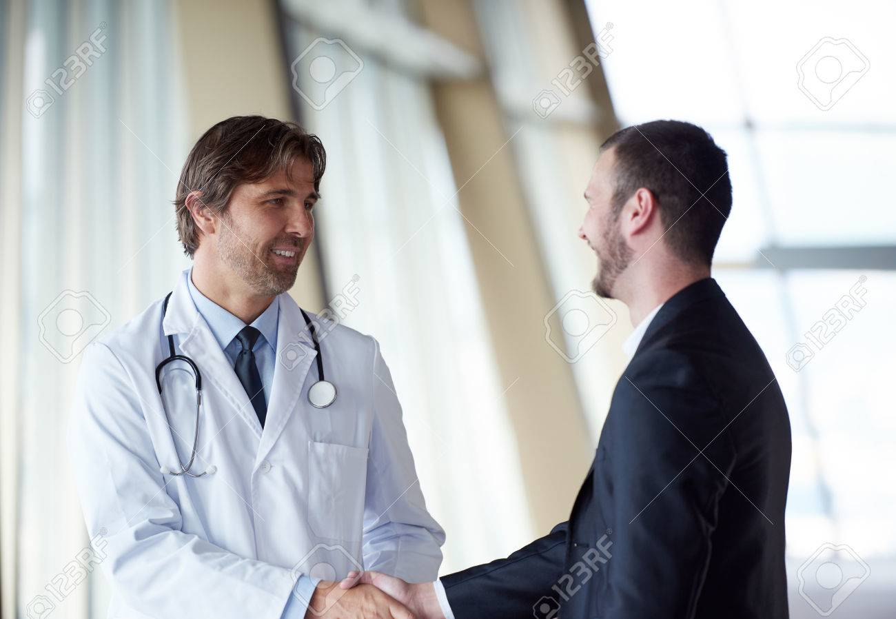 doctor handshake with a patient at doctors bright modern office in hospital Stock Photo - 49138382