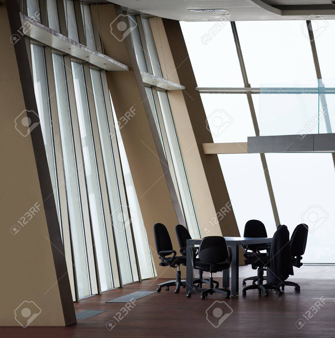 office orange. Meeting Office Room With White Modern Table And Orange Chairs Glass Wall Stock Photo