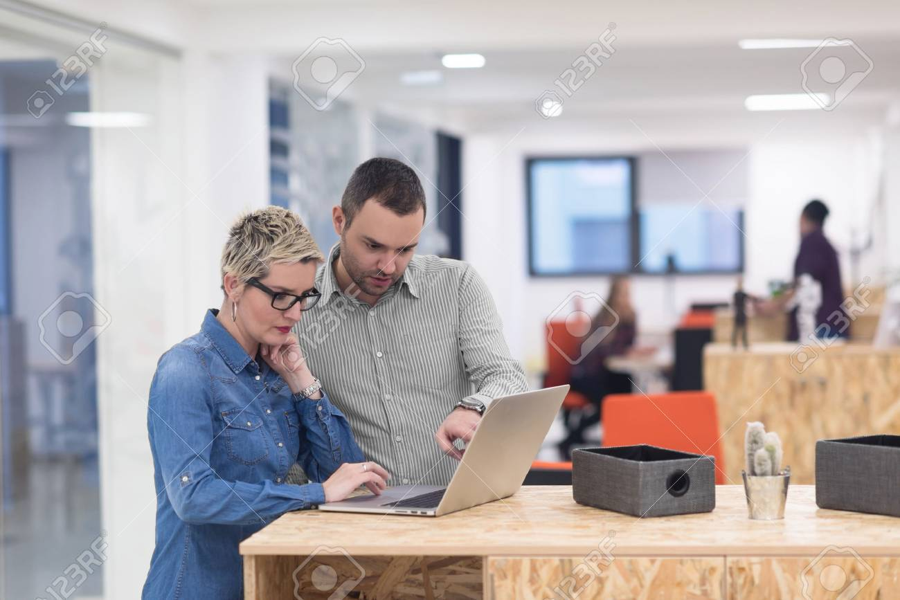 startup business team on meeting in modern bright office interior brainstorming, working on laptop and tablet computer Stock Photo - 52955727