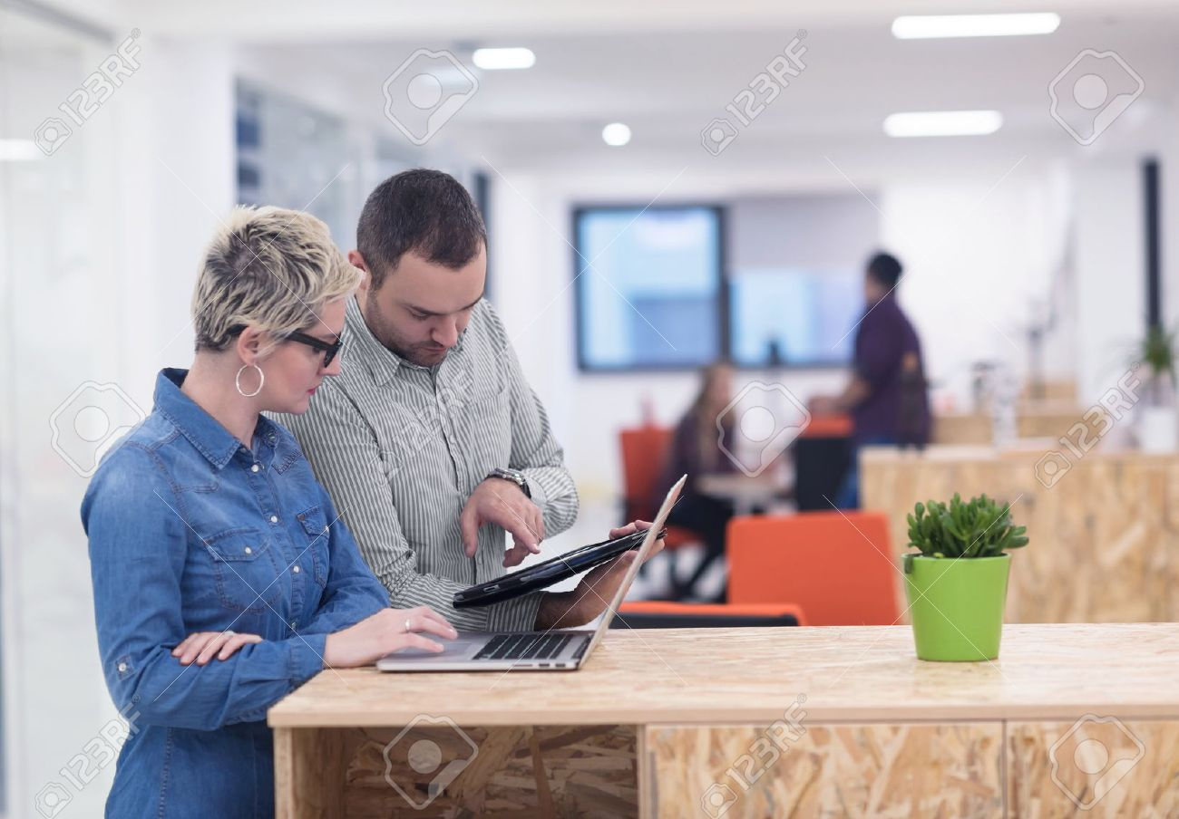 startup business team on meeting in modern bright office interior brainstorming, working on laptop and tablet computer Stock Photo - 52953453
