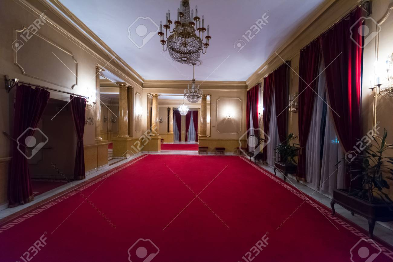 Empty Theatre Stage Curtain With Dramatic Lights Stock Photo