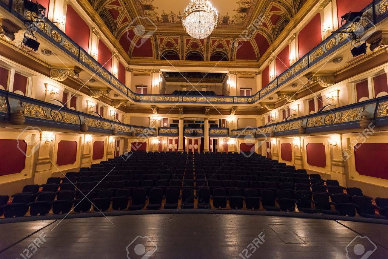 empty theater stage curtain with dramatic lights - 64140397