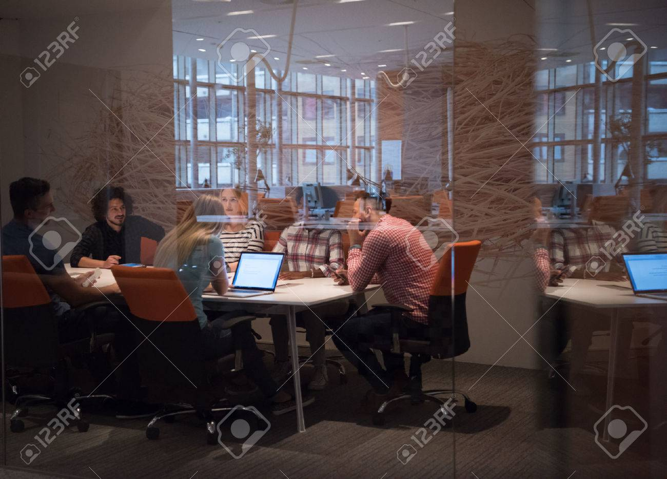 Multiethnic startup business team on meeting in modern bright office interior brainstorming, working on laptop and tablet computer - 71446408