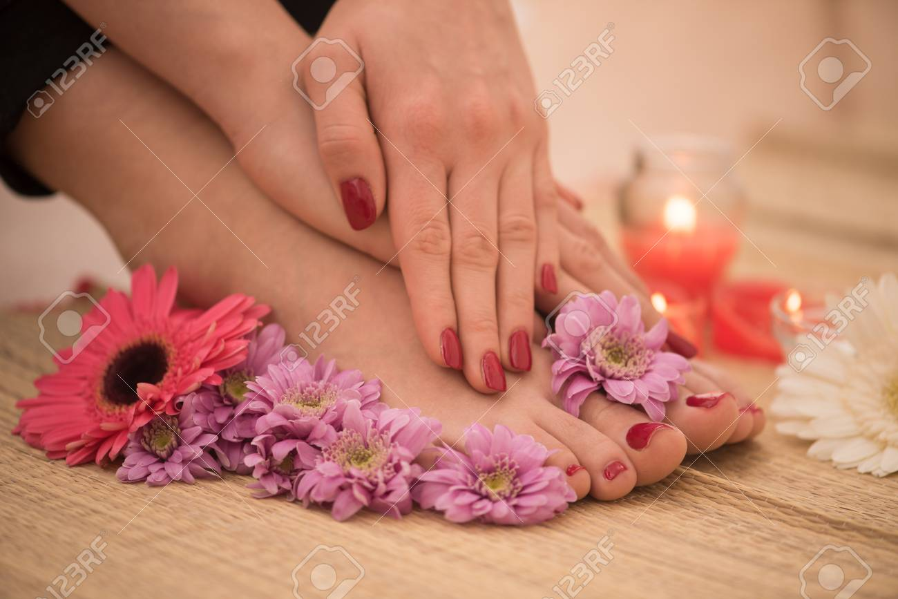Closeup photo of a female feet and hands at spa salon on pedicure and manicure procedure - 73615938