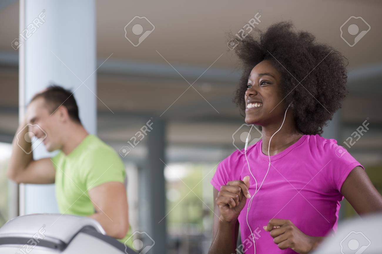 young people exercisinng a cardio on treadmill running machine in modern gym - 78201219