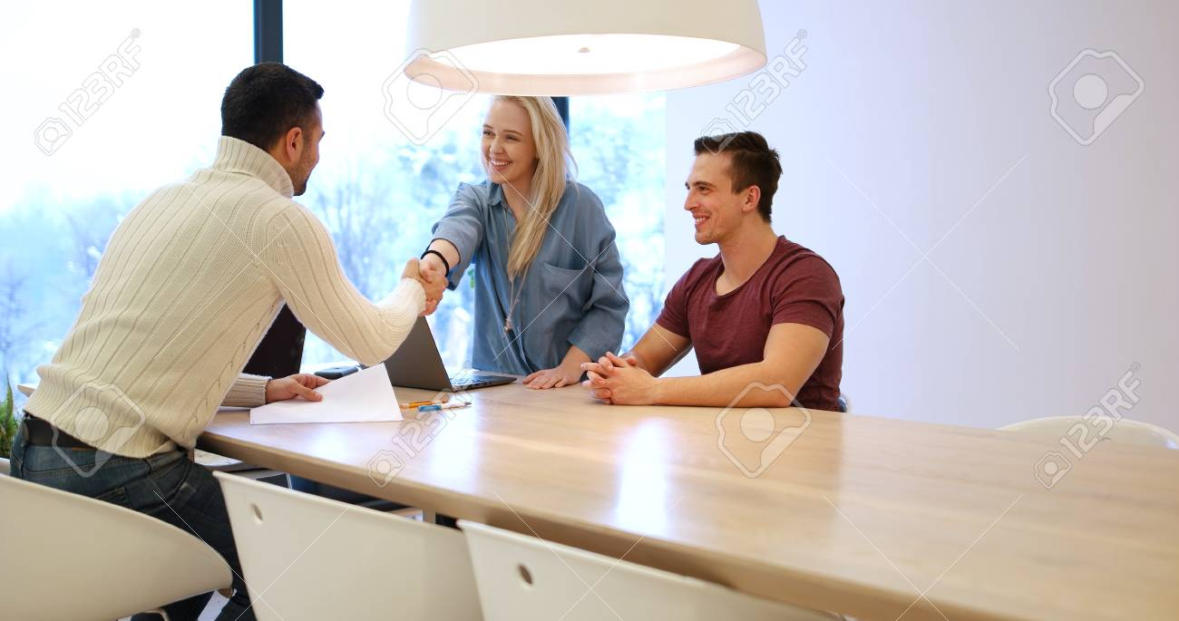 Perfect Stock Photo   Young Rich Couple Buy An Apartment, Property, House, Enter  Into A Contract With A Realtor. Signs An Agreement With The Seller