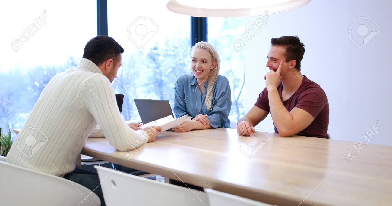 Wonderful Stock Photo   Young Rich Couple Buy An Apartment, Property, House, Enter  Into A Contract With A Realtor. Signs An Agreement With The Seller