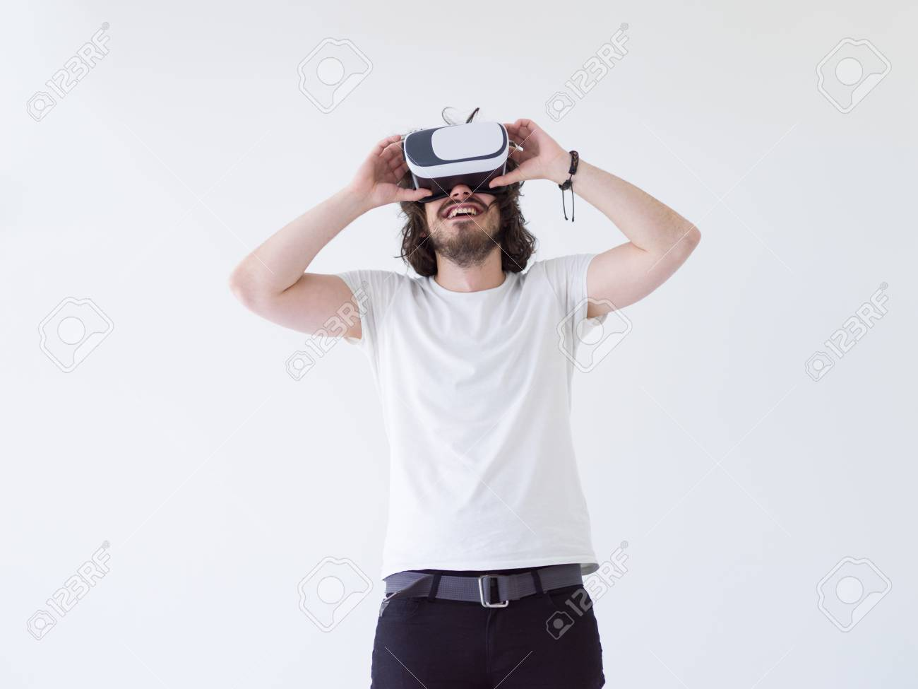 Happy man getting experience using VR headset glasses of virtual..