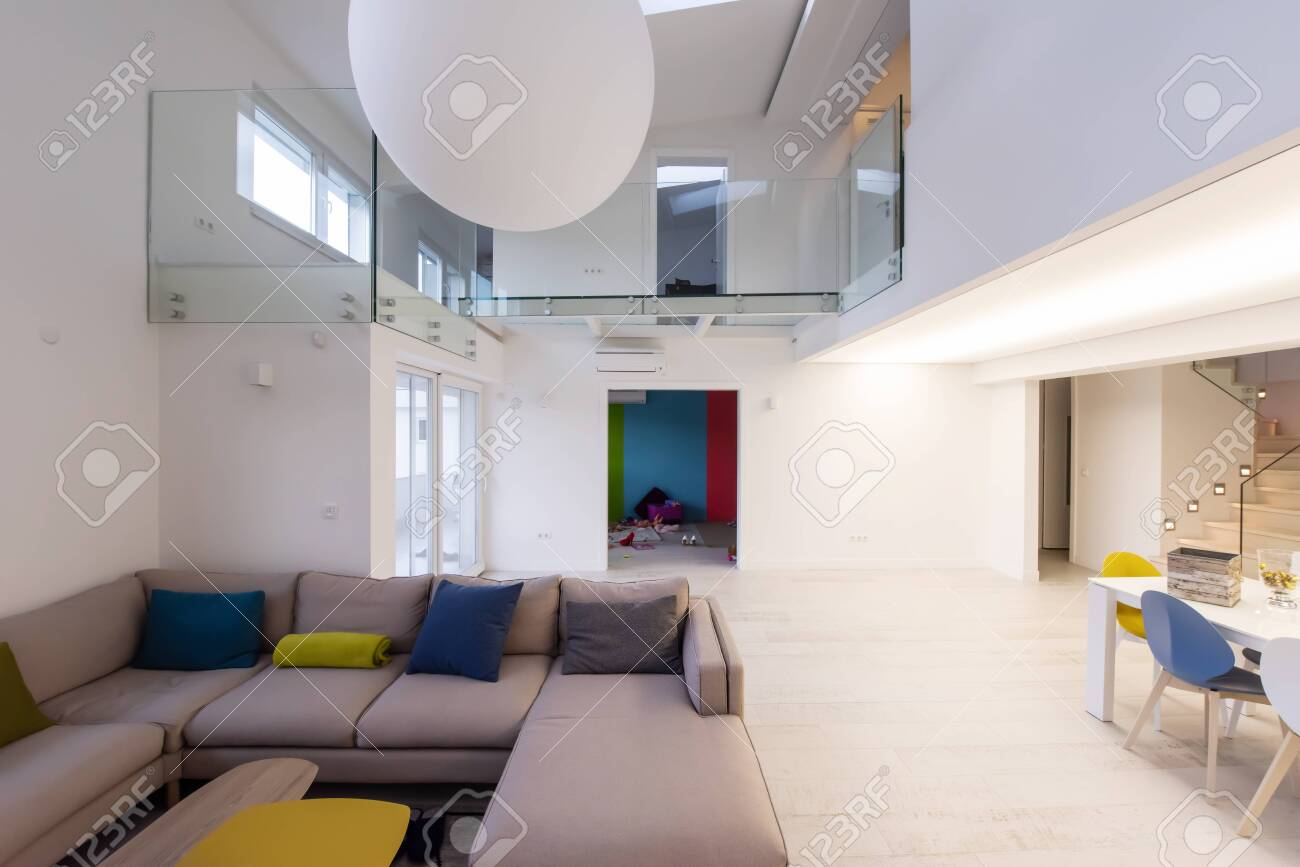 interior of a luxury stylish modern open space design two level apartment with white walls - 141499645