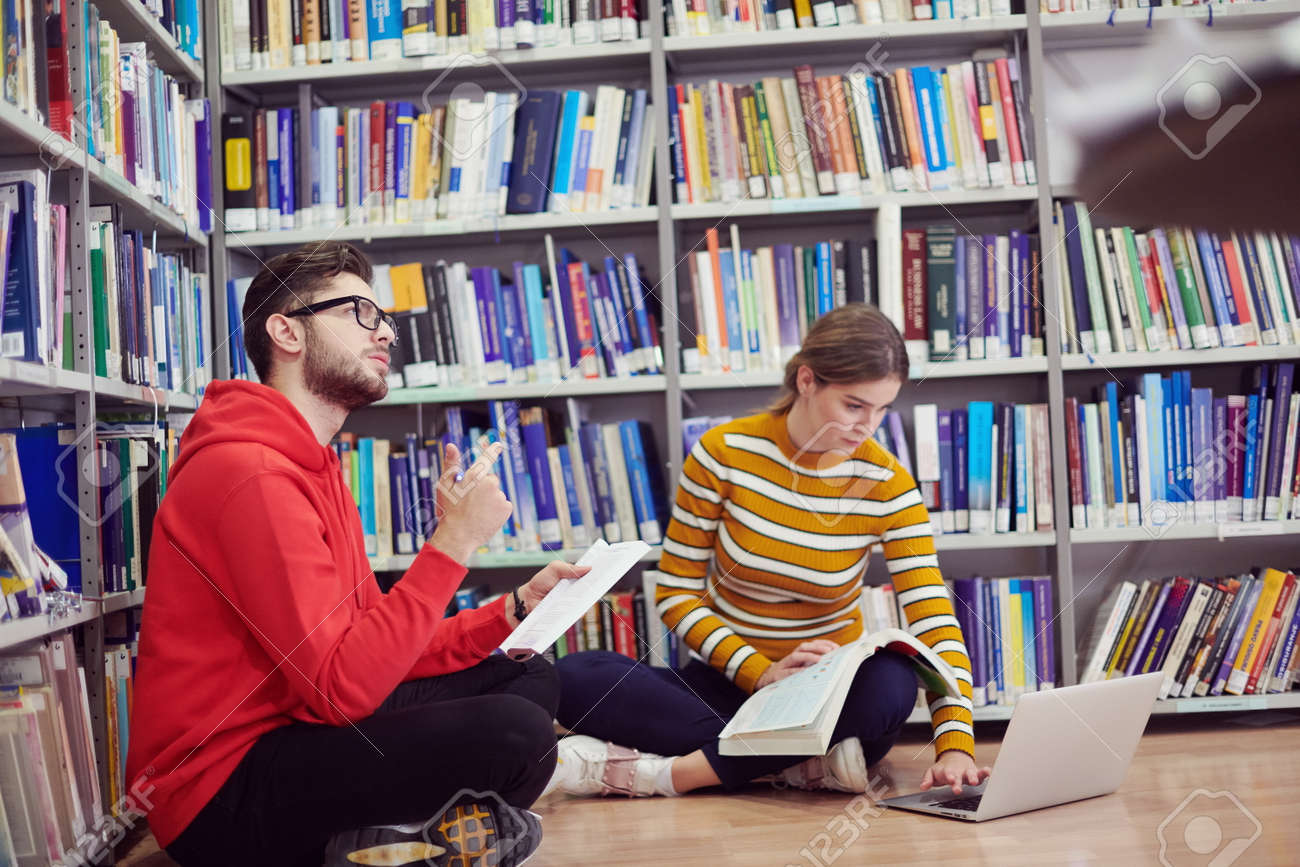the students uses a notebook, laptop and a school library - 166916435