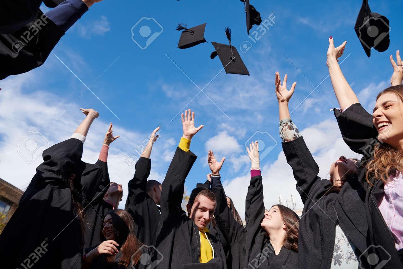 Group of diverse international graduating students celebrating - 166916725
