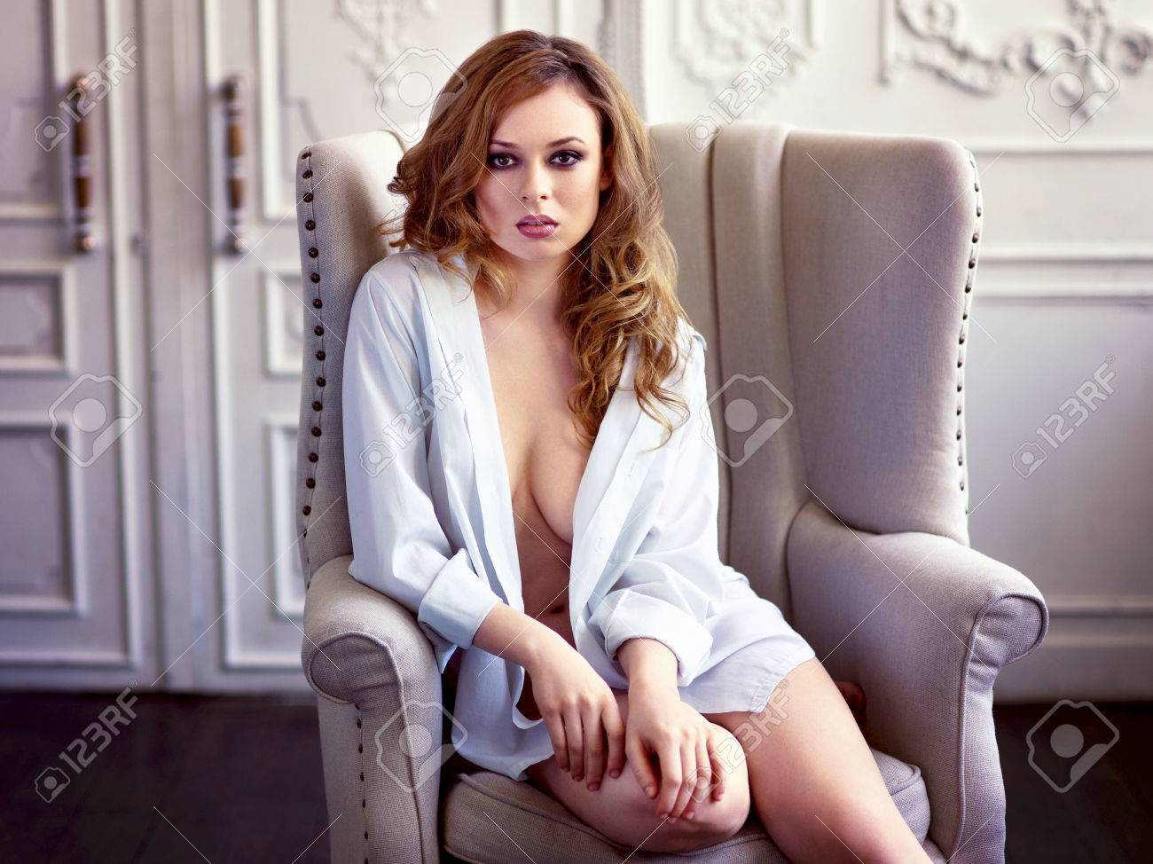 Beautiful redhair woman in white shirt - 79883188