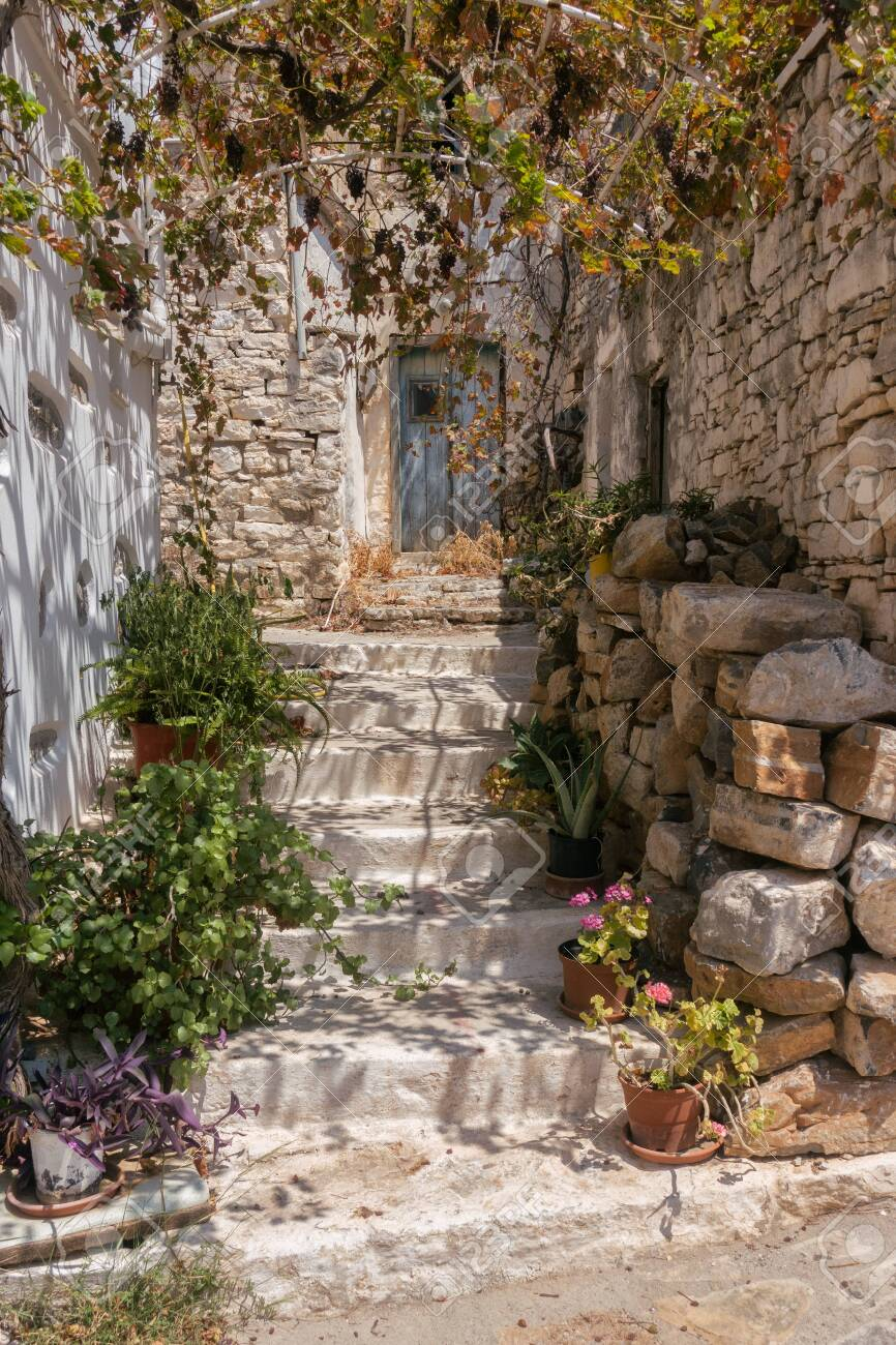 Entrance to a Greek house with a traditional blue door - 131719356