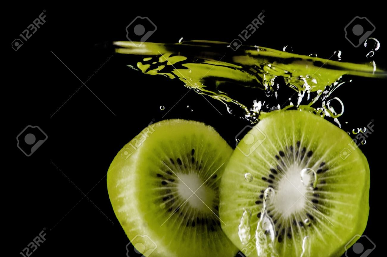 Kiwi fruit in water on a black background Stock Photo - 20867069