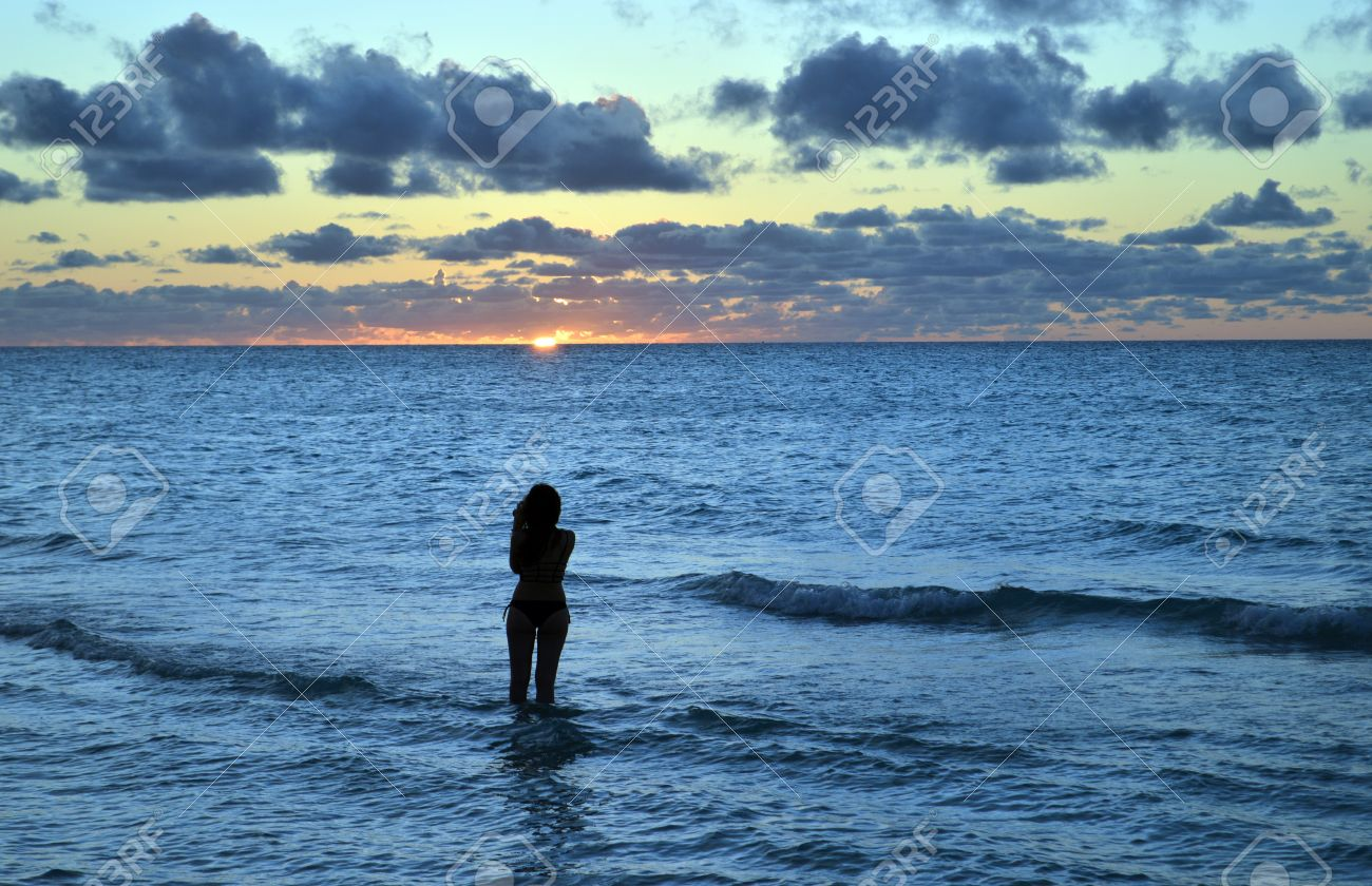 Pretty Girl Photographs Caribbean Sunset At Varadero Beach Cuba Stock Photo