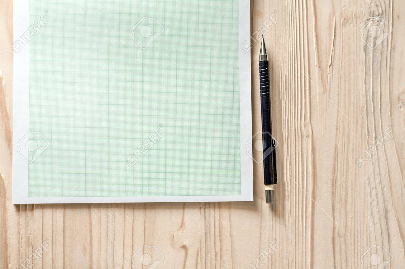 close up blank graph paper on wooden desk with copy space for