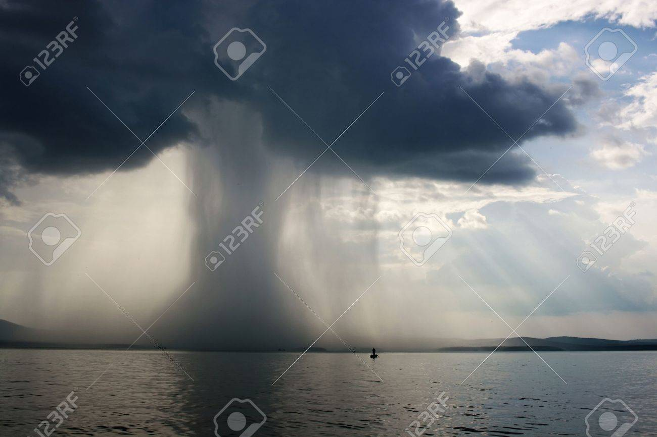 Thunderstorm cloudburst. The effective sky and lake Stock Photo - 1960930
