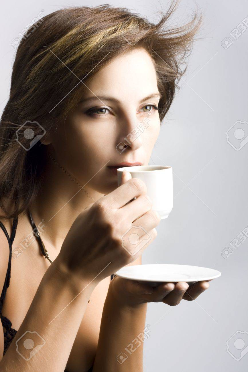 Portrait of beautiful woman drinking coffee Stock Photo - 3976193